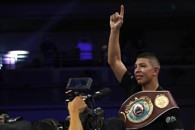 WBO junior middleweight champion Jaime Munguia of Mexico celebrates his unanimous decision victory over Liam Smith of England on July 21, 2018, in Las Vegas. (Steve Marcus/Getty Images)