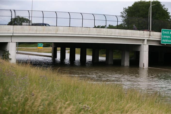Floodwaters block sections of Interstate 94 near the Livernois Avenue exit in Detroit.