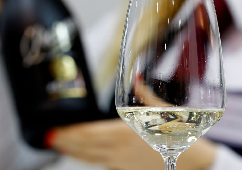 FILE PHOTO: A sommelier pours a glass of Zonin prosecco sparkling wine at the 50th Vinitaly international wine and spirits exhibition in Verona