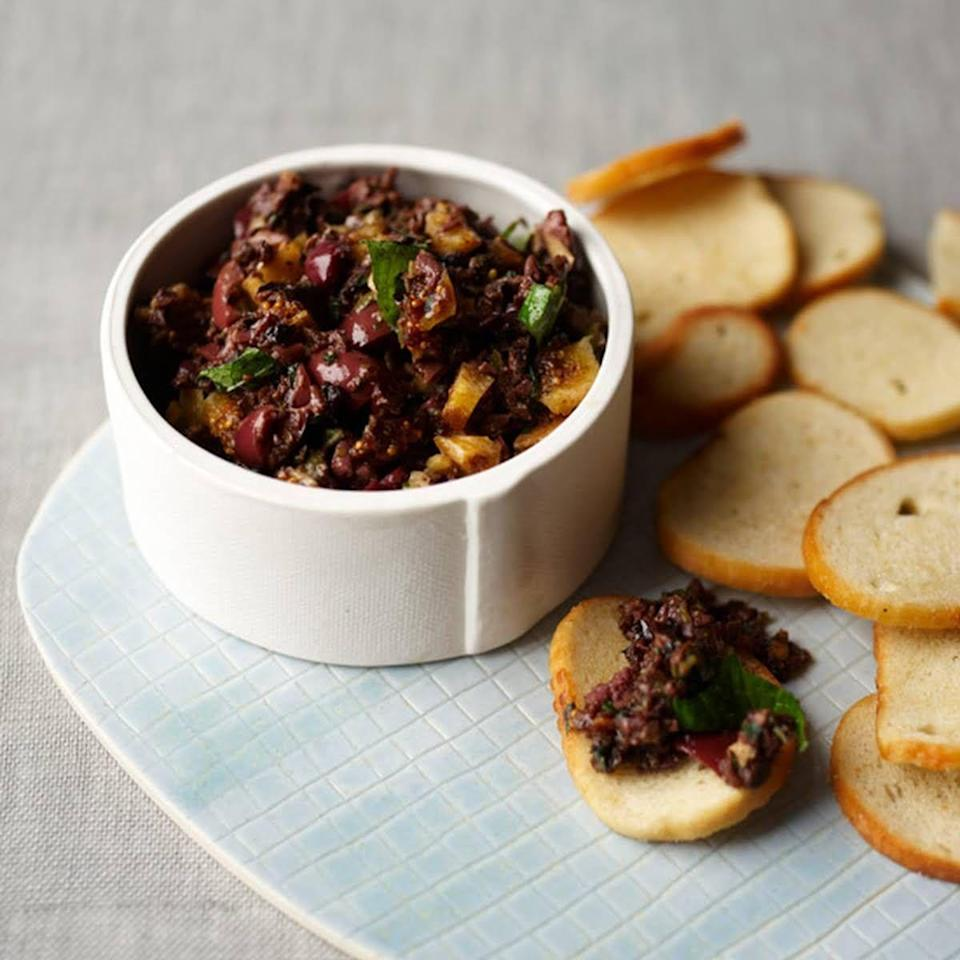 "<p>Dried figs give this tapenade a sweet, tangy flavor that pairs perfectly with crunchy bagel chips.</p><p><em><a href=""https://www.delish.com/cooking/recipe-ideas/recipes/a21124/black-olive-tapenade-figs-mint-recipe-fw0313/"" rel=""nofollow noopener"" target=""_blank"" data-ylk=""slk:Get the recipe from Delish »"" class=""link rapid-noclick-resp"">Get the recipe from Delish »</a></em></p>"