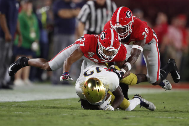 Notre Dame wide receiver Lawrence Keys III (13) is hit by Georgia defensive back Eric Stokes (27) and Georgia defensive back J.R. Reed (20) during the first half of an NCAA college football game, Saturday, Sept. 21, 2019, in Athens, Ga. (AP Photo/John Bazemore)