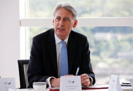 Britain's Chancellor of the Exchequer Philip Hammond attends a meeting of regional leaders of the financial and professional services in Halifax