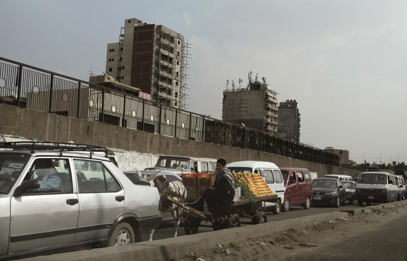 People wait in their cars in a traffic jam in Cairo, Egypt, Wednesday, Nov. 14, 2012. Metro workers in the Egyptian capital called off a strike Wednesday after five hours that brought Cairo's already notoriously snarled traffic to a standstill after the government caved in to their key demand and sacked the chairman of the subway system. (AP Photo/Nariman El-Mofty)