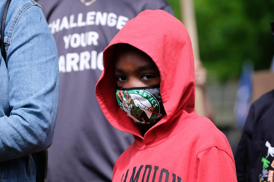 "A young boy wears a face mask during a vigil for George Floyd in Pennsylvania on May 31, 2020. <p class=""copyright"">Preston Ehrler/SOPA Images/LightRocket via Getty Images</p>"