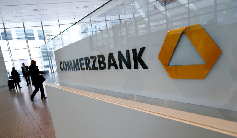 Visitors arrive at Commerzbank's headquarters before the bank's annual news conference in Frankfurt