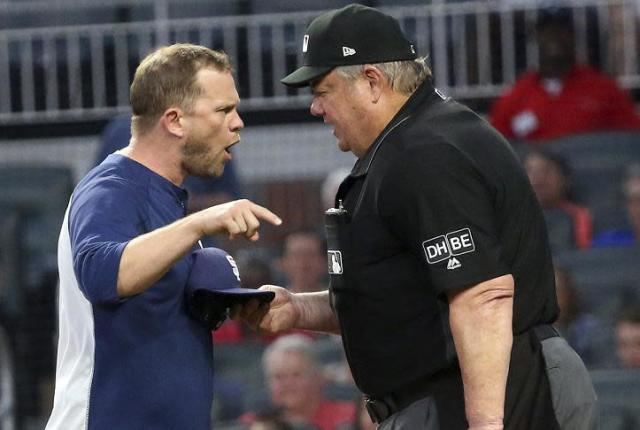 Padres manager Andy Green gives umpire Joe West an earful. (AP)
