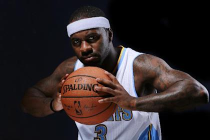 Denver Nuggets Ty Lawson poses for a portrait during NBA basketball media day, Monday, Sept. 29, 2014, in Denver. (AP Photo/Jack Dempsey)