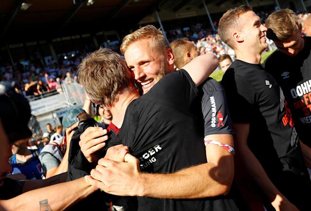 Soccer Football - 2. Bundesliga - SV Sandhausen v Nuremberg - BWT-Stadion am Hardtwald, Sandhausen, Germany - May 6, 2018 Nuremberg's Hanno Behrens celebrates promotion with team mates after the match REUTERS/Kai Pfaffenbach DFL RULES TO LIMIT THE ONLINE USAGE DURING MATCH TIME TO 15 PICTURES PER GAME. IMAGE SEQUENCES TO SIMULATE VIDEO IS NOT ALLOWED AT ANY TIME. FOR FURTHER QUERIES PLEASE CONTACT DFL DIRECTLY AT + 49 69 650050