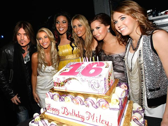 <p>At the 2008 American Music Awards, Miley had some stand-ins for her sisters. She was surprised with a cake for her 16th birthday — and Julianne Hough, Jordin Sparks, and Ashley Tisdale joined the photo op with Miley and her parents. (Photo: Michael Buckner/Getty Images for AMA) </p>