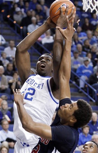 Kentucky's Alex Poythress, top, shoots over Samford's Tim Williams during the first half of an NCAA college basketball game at Rupp Arena in Lexington, Ky., Tuesday, Dec. 4, 2012. (AP Photo/James Crisp)