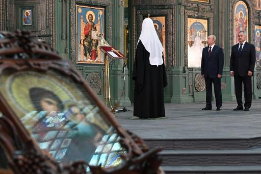 Russian President Vladimir Putin pays homage to Russia's World War II dead at an enormous new cathedral outside Moscow