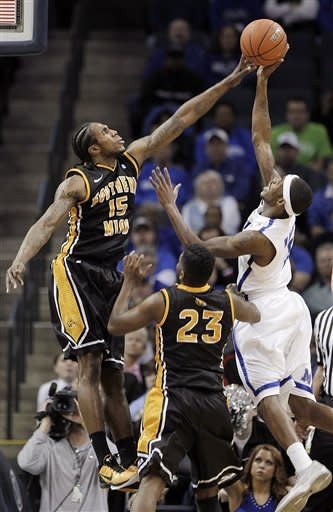 Southern Mississippi forward Torye Pelham (15) and guard Angelo Johnson (23) defend a shot by Memphis guard Will Barton (5) in the first half of an NCAA college basketball game Wednesday, Jan. 11, 2012, in Memphis, Tenn. (AP Photo/Lance Murphey)