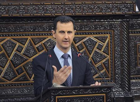 Syria's President Bashar al-Assad delivers a speech to Syria's parliament in Damascus