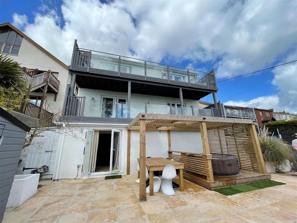 """<p>Over in Llanelli, Wales, this five-bedroom home was crowned the most-viewed of the year so far. Set over four floors, it has outstanding views across the coastline, a cinema, gym, flexible living space, <a href=""""https://www.housebeautiful.com/uk/garden/g32185721/fire-pit/"""" rel=""""nofollow noopener"""" target=""""_blank"""" data-ylk=""""slk:fire pit"""" class=""""link rapid-noclick-resp"""">fire pit</a>, outside seating, hot tub area and a bar, too.</p><p>This property is currently on the market for £550,000 with Mallard Estate Agents via <a href=""""https://www.zoopla.co.uk/for-sale/details/58518217/"""" rel=""""nofollow noopener"""" target=""""_blank"""" data-ylk=""""slk:Zoopla"""" class=""""link rapid-noclick-resp"""">Zoopla</a>.</p>"""