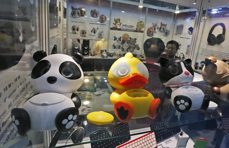 In this April 12, 2014 photo, Chinese made smart phone speakers are displayed in a booth at the Global Sources Spring China Sourcing Fair in Hong Kong. As China's economy downshifts, manufacturers are bracing for the turning point that's in store for the world's second biggest economy. (AP Photo/Kin Cheung)