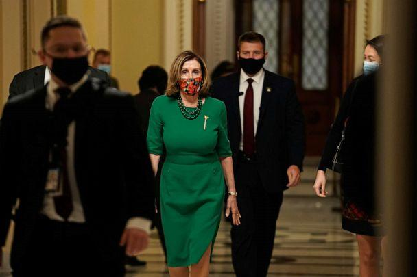 PHOTO: Speaker of the House Nancy Pelosi, D-Calif., walks from the Senate floor as both chambers of Congress are aimed to pass the COVID-19 package in a marathon session on Capitol Hill, Dec. 21, 2020. (Ken Cedeno/Reuters)