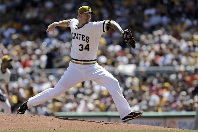 Pittsburgh Pirates starting pitcher A.J. Burnett (34) delivers during the third inning of a baseball game against the Colorado Rockies in Pittsburgh Sunday, Aug. 4, 2013. (AP Photo/Gene J. Puskar)