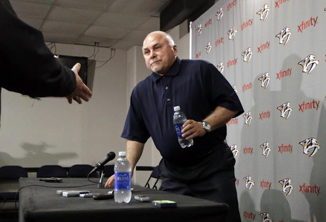 A well-wisher reaches to shake hands with Nashville Predators coach Barry Trotz as Trotz leaves a news conference Monday, April 14, 2014, in Nashville, Tenn. The Predators announced earlier in the day that Trotz's contract won't be extended and they will begin looking for a new head coach. Trotz is the only head coach the NHL hockey team has had. (AP Photo/Mark Humphrey)