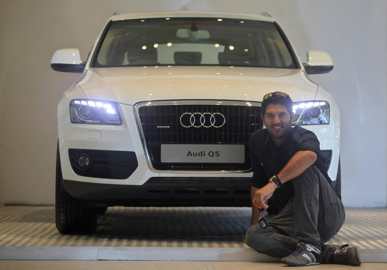 Indian cricketer Yuvraj Singh poses with an Audi Q5 in Mumbai, India, Thursday, April 14, 2011. Audi, the German luxury car manufacturer, presented Singh with the Audi Q5 for his performance in the ICC World Cup 2011.