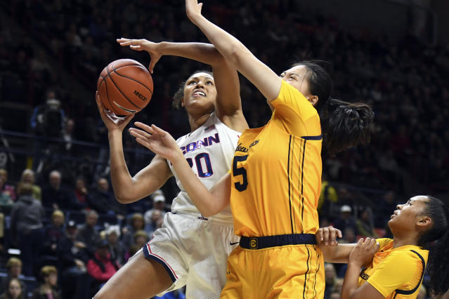 Connecticut's Olivia Nelson-Ododa (20) is fouled by California's Chen Yue (5) in the first half of a women's NCAA college basketball game, Sunday, Nov. 10, 2019, in Storrs, Conn. (AP Photo/Stephen Dunn)