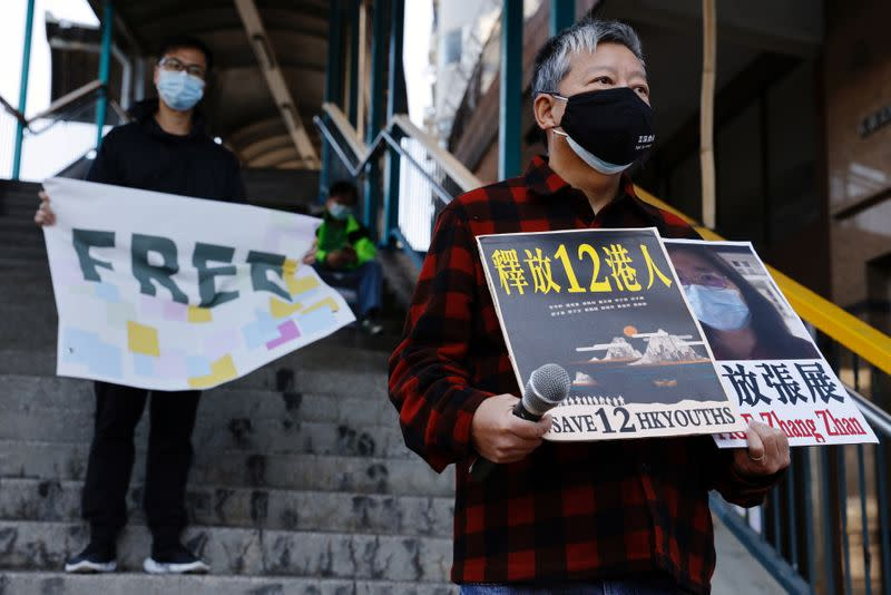Pro-democracy supporters protest to urge for the release of 12 Hong Kong activists arrested as they reportedly sailed to Taiwan for political asylum and citizen journalist Zhang Zhan outside China's Liaison Office, in Hong Kong