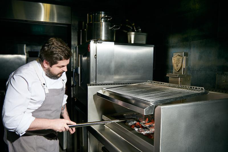 Chef Aitor prepping the Basque Grill oven. Photo: Basque Kitchen by Aitor