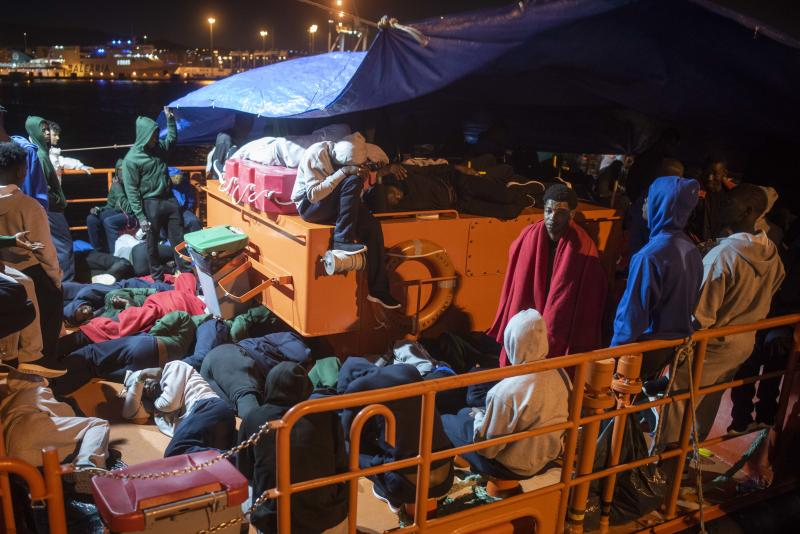 In this photo taken late Wednesday, July 25, 2018, migrants spend the night onboard a Spanish Maritime Rescue Service boat at the port of Algeciras, southern Spain, after being rescued in the Strait of Gibraltar. Around 800 migrants stormed border fences separating Spain's North African enclave of Ceuta from Morocco to get into Europe, police said Thursday.(AP Photo/Marcos Moreno)