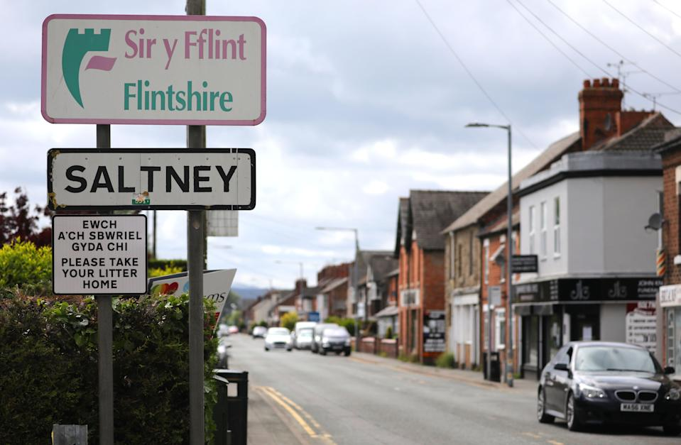Boundary Lane, Saltney. The road is the border between Flintshire in North Wales and Cheshire, England. Residents on one side are free to travel and meet individually, while on the other side in Wales, the country remains unchanged and in lockdown. Pictured: Saltney sign. Photo by Ian Cooper