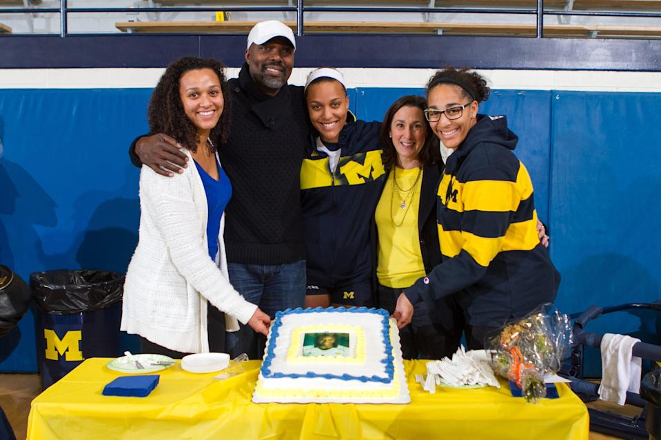 Molly Toon (center) celebrates senior day at the University of Michigan in 2013, flanked by her family (from left) sister Kirby, father Al, mother Jane and sister Sydney.