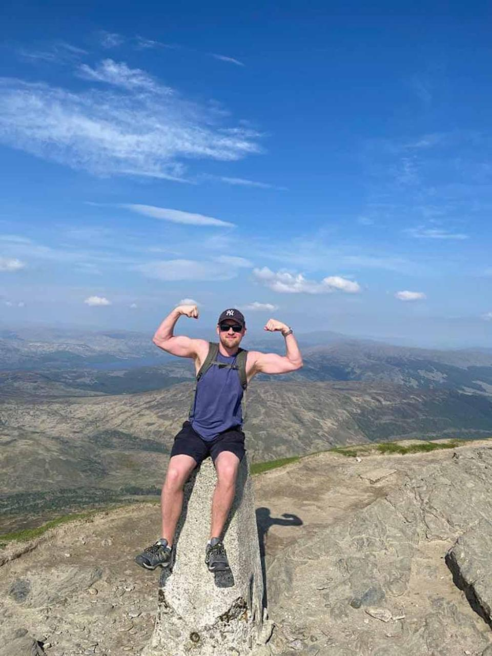 Neil Kennedy, pictured climbing Ben Lomond in Scotland in June 2021, has saved thousands via yellow sticker shopping. PA REAL LIFE COLLECT