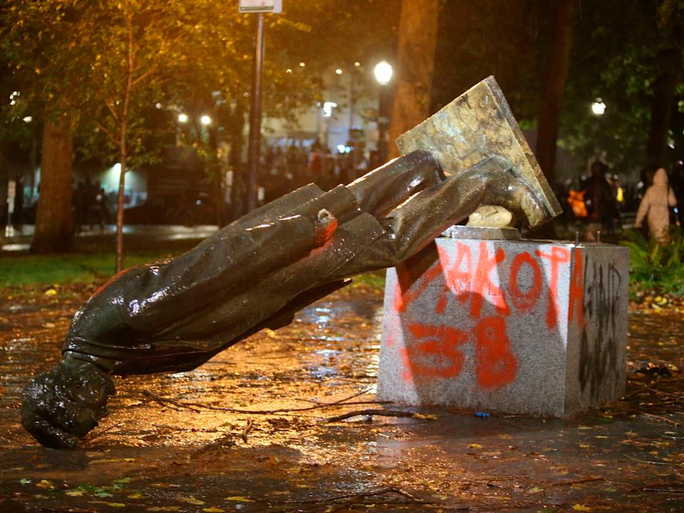 A group of protesters toppled statues of former presidents Theodore Roosevelt and Abraham Lincoln in Portland's South Park Block late Sunday, 11 October, 2020 ((The Associated Press))