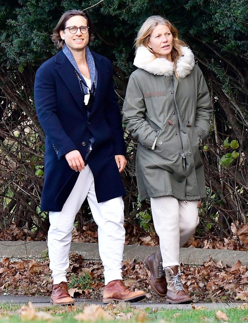 <p>Gwyneth Paltrow and husband Brad Falchuk bundle up to go for a walk on Sunday in the Hamptons.</p>