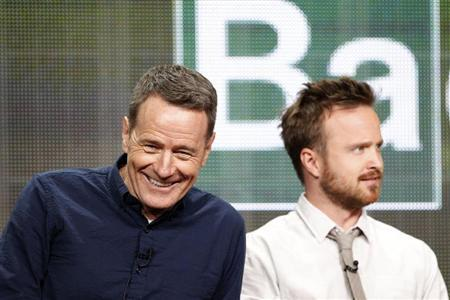 """Cranston smiles next to Paul at a panel for the television series """"Breaking Bad"""" during the AMC portion of the Television Critics Association Summer press tour in Beverly Hills"""