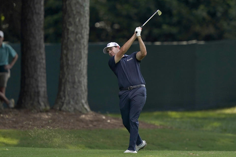 Patrick Cantlay hits from the fairway on the 14th hole during the final round of play in the Tour Championship golf tournament at East Lake Golf Club, Sunday, Sept. 5, 2021, in Atlanta. Cantlay won the event and the FedEx Cup. (AP Photo/Brynn Anderson)