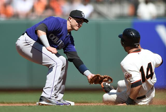 SAN FRANCISCO, CA - APRIL 13: Brandon Hicks #14 of the San Francisco Giants tagged out stealing by Troy Tulowitzki #2 of the Colorado Rockies in the bottom of the seventh inning at AT&T Park on April 13, 2014 in San Francisco, California. (Photo by Thearon W. Henderson/Getty Images)
