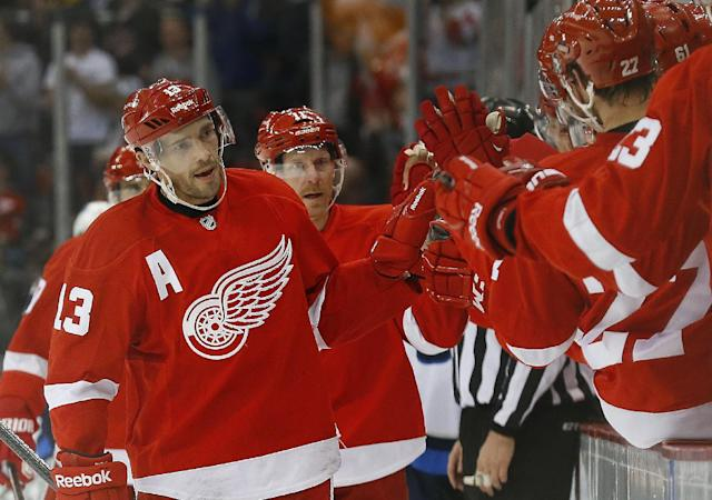 Detroit Red Wings center Pavel Datsyuk (13), of Russia, celebrates his goal against the Winnipeg Jets in the first period of an NHL hockey game in Detroit, Tuesday, Nov. 12, 2013. (AP Photo/Paul Sancya)