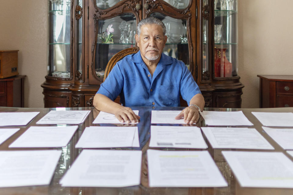 In this undated photo provided by the Institute for Justice, Vietnam veteran José Oliva reviews documents from his lawsuit after he was put in a chokehold and thrown to the ground by federal police officers in an altercation that was caught on camera at the VA hospital in El Paso, Texas in 2016. (Institute for Justice via AP)