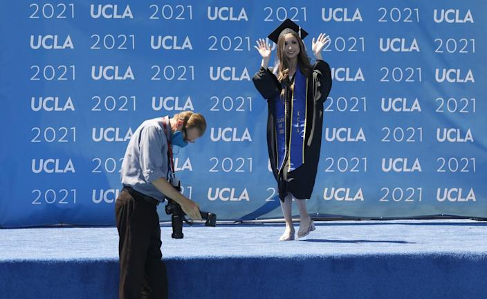 Graduating with a degree in Communication Studies and Business/Economics, Maddie Park waves