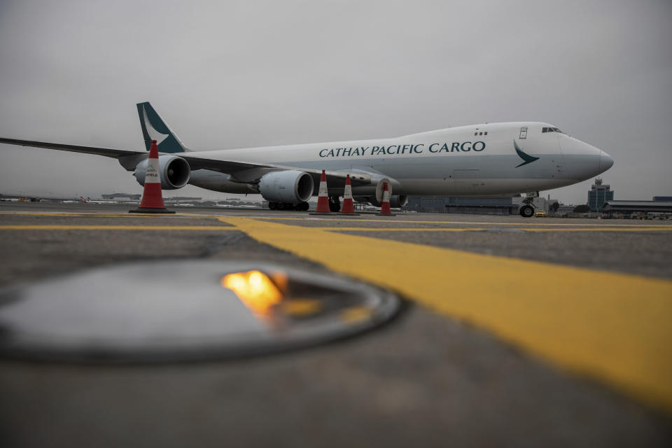 A Cathay Pacific cargo plane carrying Pfizer-BioNTech coronavirus vaccines prepares to dock at the Hong Kong International Airport in Hong Kong, Saturday, Feb. 27, 2021. (Jerome Favre/Pool Photo via AP)