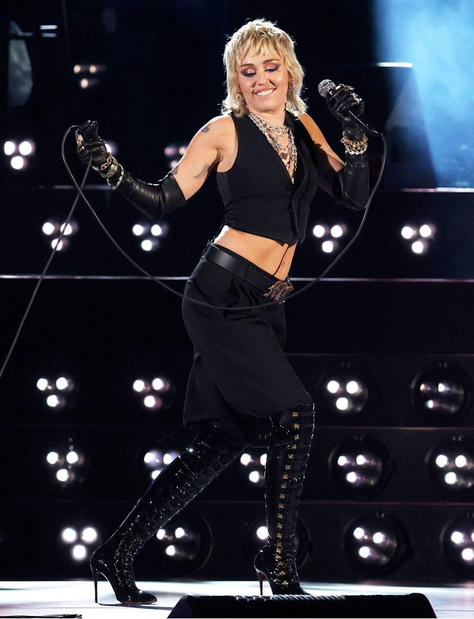<p>Miley Cyrus hits the stage to perform a tribute to frontline heroes during the 2021 NCAA Final Four at Lucas Oil Stadium on Saturday in Indianapolis, Indiana.</p>