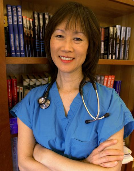 "FILE - In this Nov. 5, 2002 file photo, Tess Gerritsen, an author and one of the biggest names in the medical thriller genre, stands in the library at her home in Camden, Maine. Gerritsen is suing the studio behind the hit film ""Gravity"" claiming it is based on one of her novels. Gerritsen's lawsuit filed Tuesday, April 29, 2014, against Warner Bros. Entertainment Inc. seeks more than $10 million from the studio behind the Oscar-winning film, which starred Sandra Bullock. (AP Photo/Pat Wellenbach, file)"