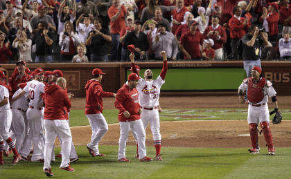 Cardinals players celebrate on the field after their 3-2 victory over the Dodgers on Tuesday. (AP)