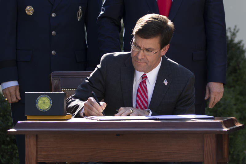 Secretary of Defense Mark Esper signs a document announcing the establishment of the U.S. Space Command during an event in the Rose Garden of the White House, Thursday, Aug. 29, 2019, in Washington. (AP Photo/Carolyn Kaster)