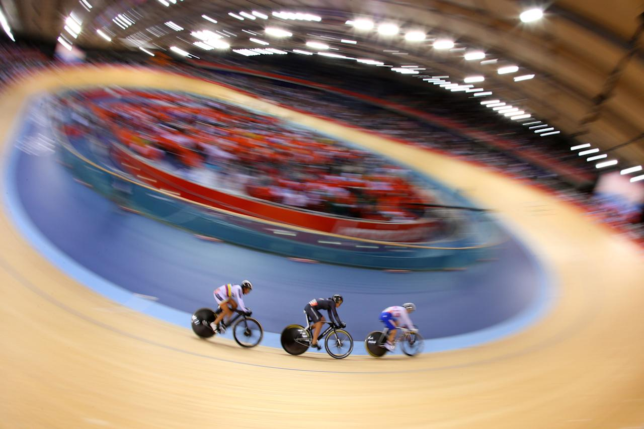 (L-R) Juliana Gaviria of Colombia, Natasha Hansen of New Zealand and Ekaterina Gnidenko of Russia compete in the Women's Sprint Track Cycling 1/16 Final Repechages on Day 9 of the London 2012 Olympic Games at Velodrome on August 5, 2012 in London, England.   (Photo by Cameron Spencer/Getty Images)