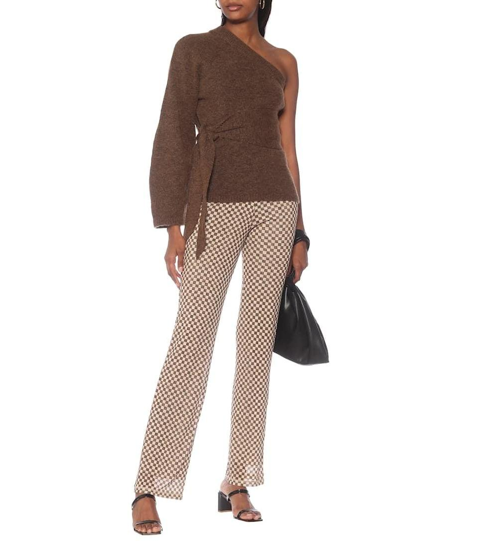 "<p>""This season, I treated myself to this <span>Nanushka Cleto Belted One-shoulder Sweater</span> ($344). I'm obsessed with the neutral brown color; it looks so polished and gorgeous. Plus, the one-shoulder is sophisticated and cool."" - IY</p>"