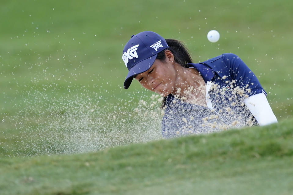 Celine Boutier of France hits from the greenside bunker on the first hole, during the final round of play in the KPMG Women's PGA Championship golf tournament, Sunday, June 27, 2021, in Johns Creek, Ga. (AP Photo/John Bazemore)