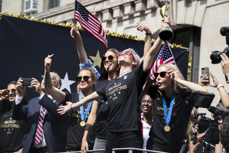 Megan Rapinoe of United States holds the 2019 FIFA World Cup Champion Trophy on the World Champions float as it rides down Broadway for the Ticker Tape through the Canyon of Heroes on July 10, 2019, USA. (Photo by Ira L. Black/Corbis via Getty Images)