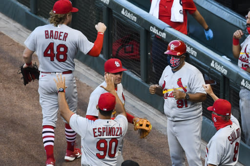 St. Louis Cardinals' Brad Miller, center, celebrates with teammates after Game 1 of a baseball doubleheader against the Chicago Cubs, Monday, Aug. 17, 2020, in Chicago. (AP Photo/Matt Marton)