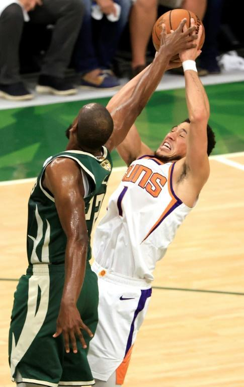 Phoenix's Devin Booker, right, has a shot blocked by Milwaukee's Khris Middleton in game three of the NBA Finals