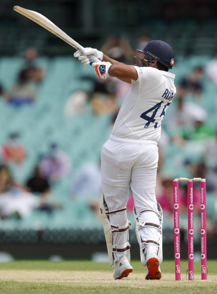 India's Rohit Sharma bats during play on day two of the third cricket test between India and Australia at the Sydney Cricket Ground, Sydney, Australia, Friday, Jan. 8, 2021. (AP Photo/Rick Rycroft)